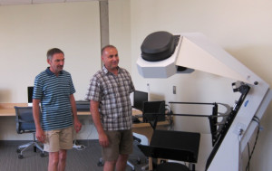 Visiting archivists excited to see the Lab's rare book scanner