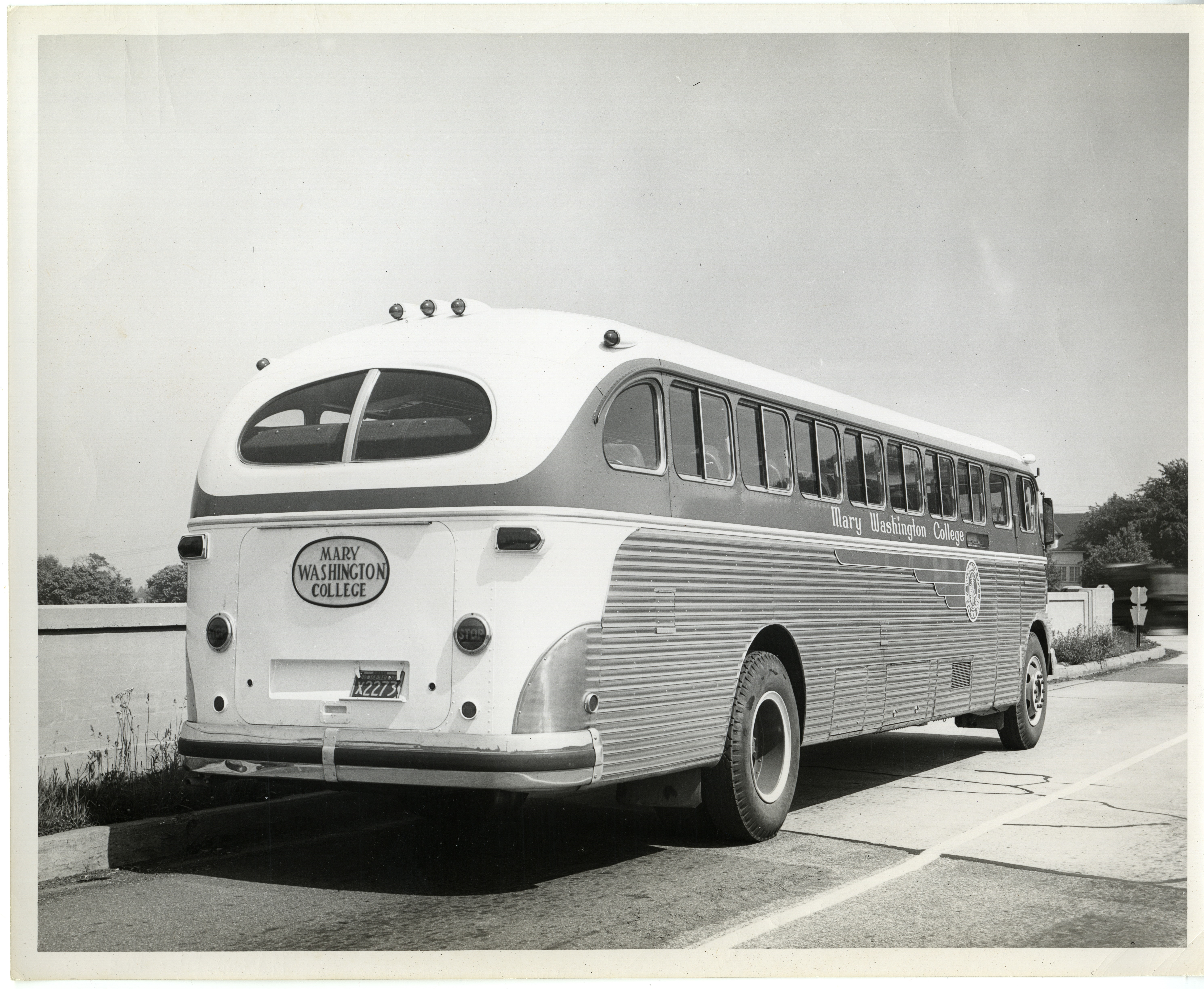 """Black and white image of a 1950s-era bus. The side and rear of the bus say """"Mary Washington College""""."""