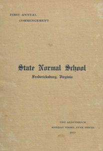 Photograph of the light tan cover of the First Commencement Program, 1912