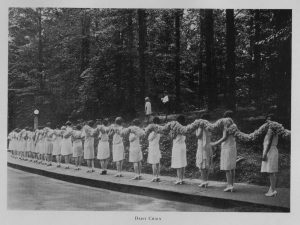 One of the annual events of the early commencements was the creation of the daisy chain. It was the task of the freshmen to gather daisies and tie them into bunches, fashioning the finished chain. Graduates receiving two-year diplomas carried the chain into the amphitheater and laid it on the sides as a decorative backdrop. The daisy chain continued to be a feature of Class Day exercises until 1942.